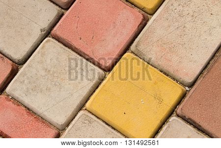 brickwork of colored paving brick. closeup natural light, a top view