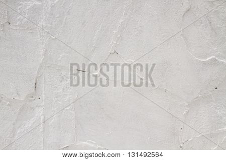 Texture uneven whitewashed old white wall. abstract