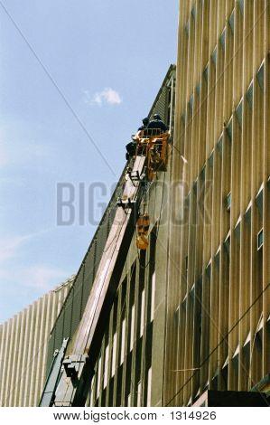 Men Cleaning Windows