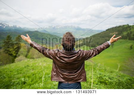 Happy man enjoying the spectacular mountain. Outdoors shot in the mountains