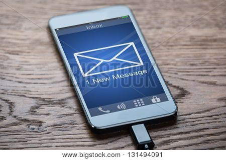 Close-up Of A Mobile Phone With One New Message Received In Its Inbox