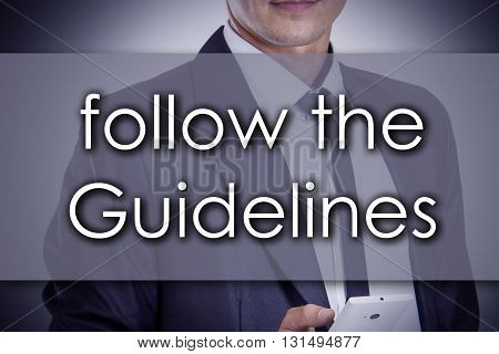 Follow The Guidelines - Young Businessman With Text - Business Concept