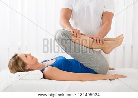 Close-up Of Man Giving Massage To Mature Woman In Spa