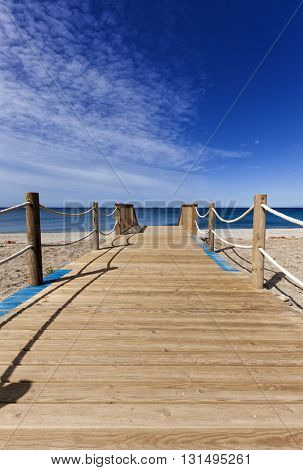Wooden path to the beach of Fabriquilla, Almeria province