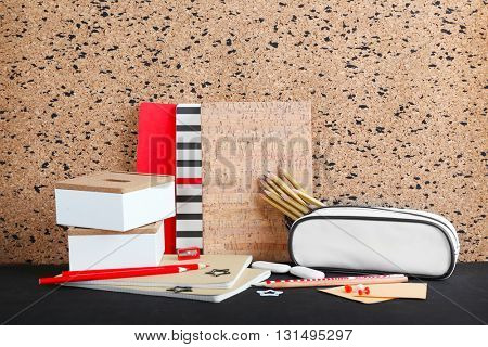 Stationery  on black wooden table.
