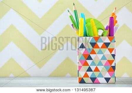 Stationery in box on color background