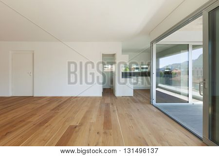 Interior of empty apartment, wide hall with parquet floor