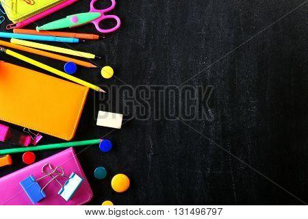 Colourful stationery on black background