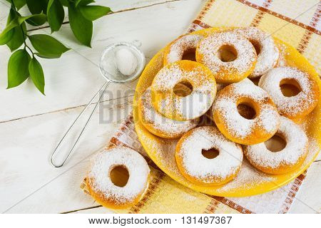 Sweet donuts powdered by caster sugar. Doughnuts. Sweet pastry. Sweet dessert. Donuts.