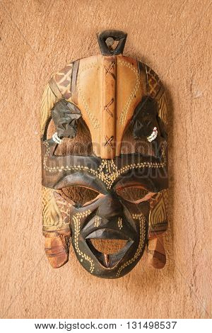 Old Wooden Mask on the clay wall.