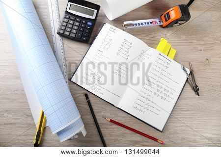 School supplies and textbook on mathematics close up