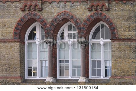 Antique closed windows on old building facade