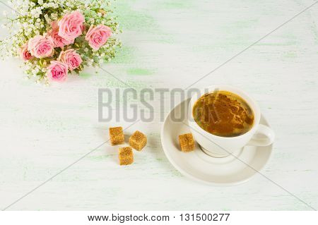 Romantic morning coffee with roses. Coffee cup. Strong coffee. Coffee mug. Cup of coffee.Morning coffee. Coffee break.