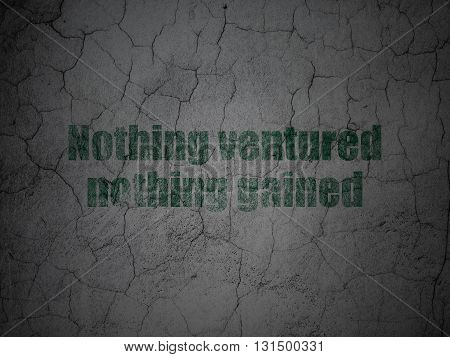 Finance concept: Green Nothing ventured Nothing gained on grunge textured concrete wall background
