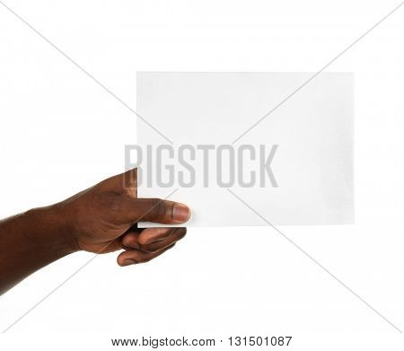 Male hands holding sheet of paper isolated on white
