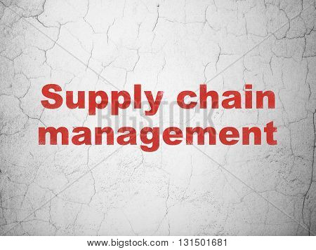 Marketing concept: Red Supply Chain Management on textured concrete wall background