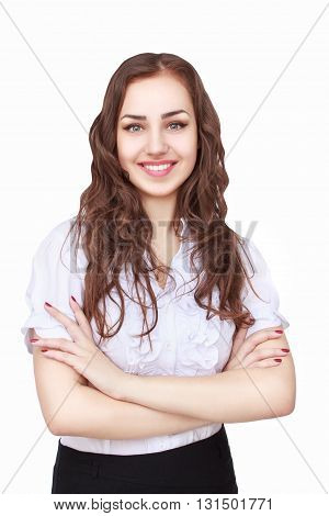 Young succesfull businesswoman with crossed hands on isolated background