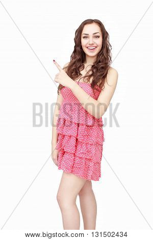 Happy young woman pointing up on something isolated on white background