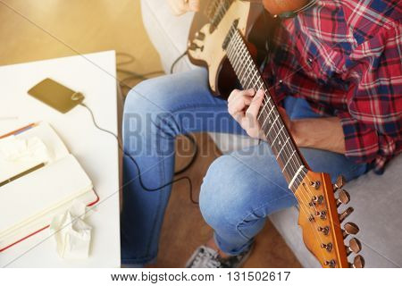 Man with guitar indoors