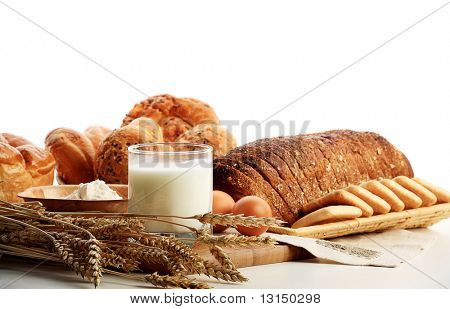 Baking ingredients, milk, and pastry isolated on white background