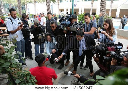 ANAHEIM CALIFORNIA, May 25, 2016: Various new agencies scramble to interview a protester after he was questioned by the police at the Republican Nominee Donald J. Trump Rally Anaheim   5.25.2016