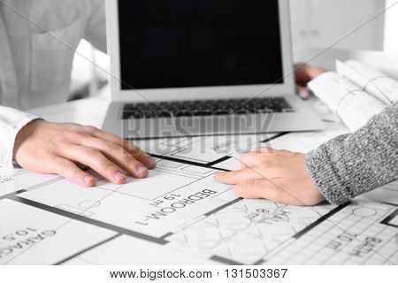 Architects sketching construction project closeup