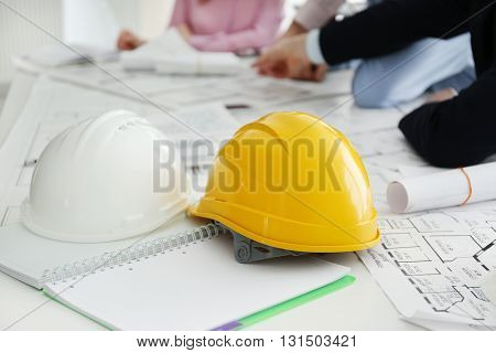 Helmets and blueprints on the office table