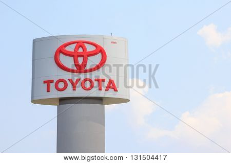 NAKORN RATCHASIMATHAILAND - April 21 2016 : An emblem of Toyota dealer shot in front of Toyota dealer Thailand April 21 2016 Korat Thailand. Toyota Motor Corporation is headquartered in ToyotaJapan.