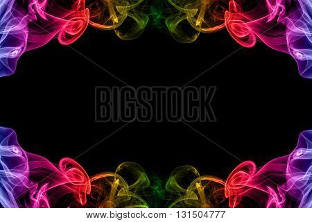 abstract frame from movement of rainbow smoke on black background for graphic design with copy space
