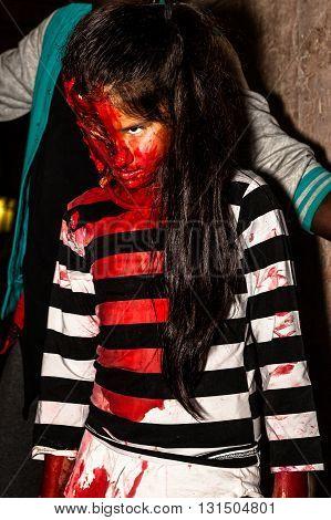 Bologna, Italy - May 21, 2016: Bologna zombie apocalypse walk. Halloween costume zombie bloody child.