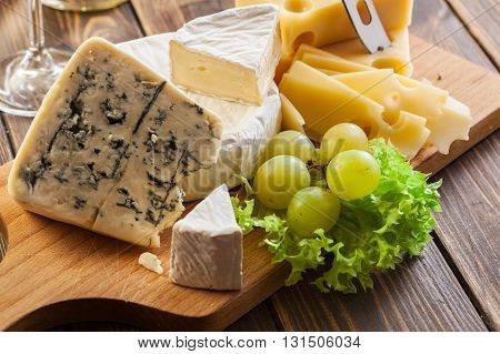 Set Of Different Cheeses