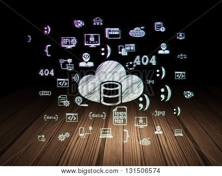 Database concept: Glowing Database With Cloud icon in grunge dark room with Wooden Floor, black background with  Hand Drawn Programming Icons
