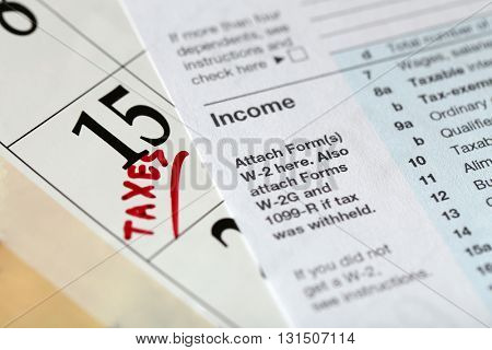 A red tax mark in the calendar, close up