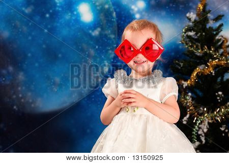 Christmas theme: happy mother in Santas cap with her daughter in funny glasses.