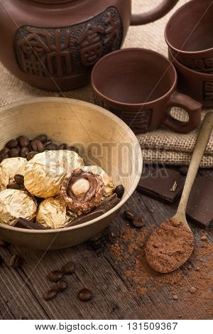 Italian chocolate sweets with decoration on the wooden table