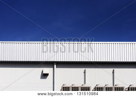 the factory made from sheet metal with the blue sky