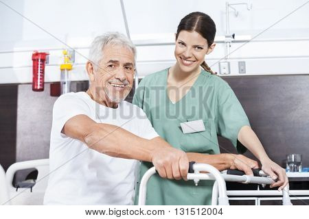 Nurse And Senior Patient With Walker At Rehab Center