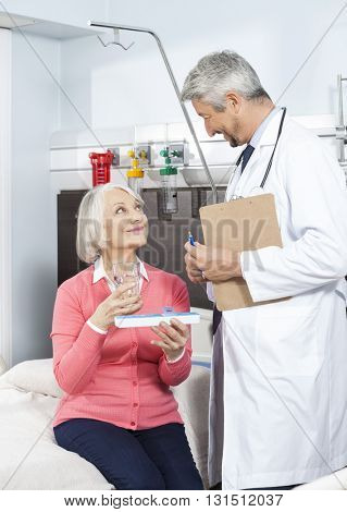 Patient Holding Medicine Organizer And Glass While Looking At Do
