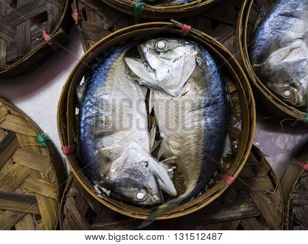Thai gulf Mackerel fish boiled cooking ready to eat pre-sale in bamboo tray in tradition market thailand.