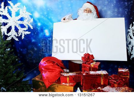 Christmas theme: Santa  gifts, snowy design.
