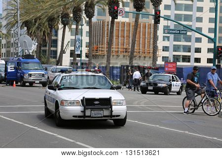 ANAHEIM CALIFORNIA, May 25, 2016: Police in riot gear and in cars  protect both supporters and protesters from each other during the Republican Nominee Donald J. Trump Rally Anaheim 5.25.2016