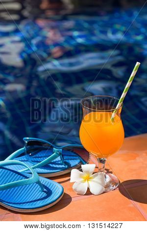 Orange Mango Fresh Juice Smoothie Drink Cocktail Slippers And Sunglasses Near Swimming Pool - Summer