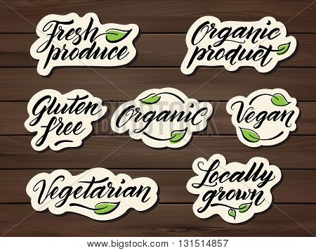 Hand drawn healthy food letterings. Label, badge, logo template on a wooden background. Eps 10 vector.