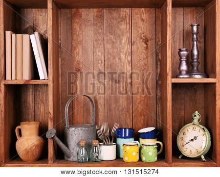 Wooden shelves with antiques things