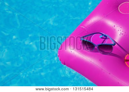 Sunglasses Pink Air Mattress Swimming Pool. Tropical Concept