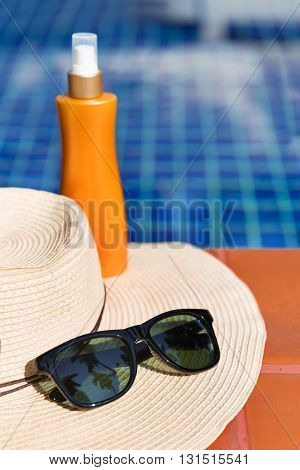 Sunscreen Cream And Sun Glasses With Straw Hat Swimming Po