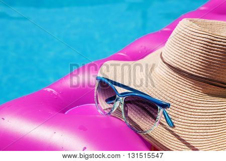 Sunglasses Straw Hat Pink Air Mattress Swimming Pool. Tropical Concept