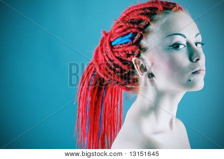 Fashionable young woman with red dreadlocks.
