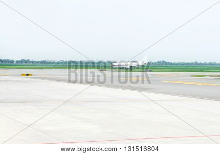 looking at airplane in landing strip in airport.