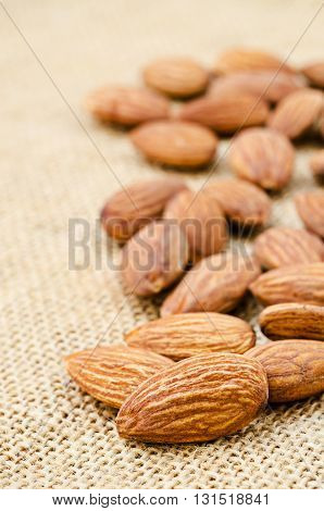 close up some almonds on sack background.